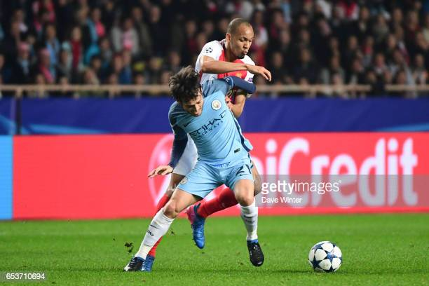 David Silva of Manchester City and Fabinho of Monaco battle for the ball during the Uefa Champions League match between As Monaco and Manchester City...