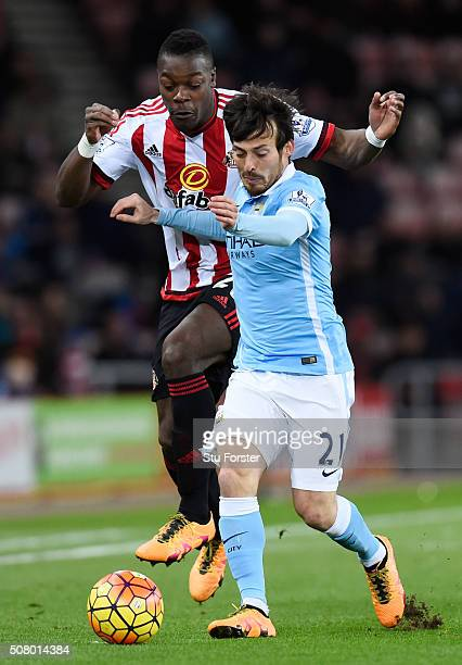 David Silva of Manchester City and Lamine Kone of Sunderland compete for the ball during the Barclays Premier League match between Sunderland and...