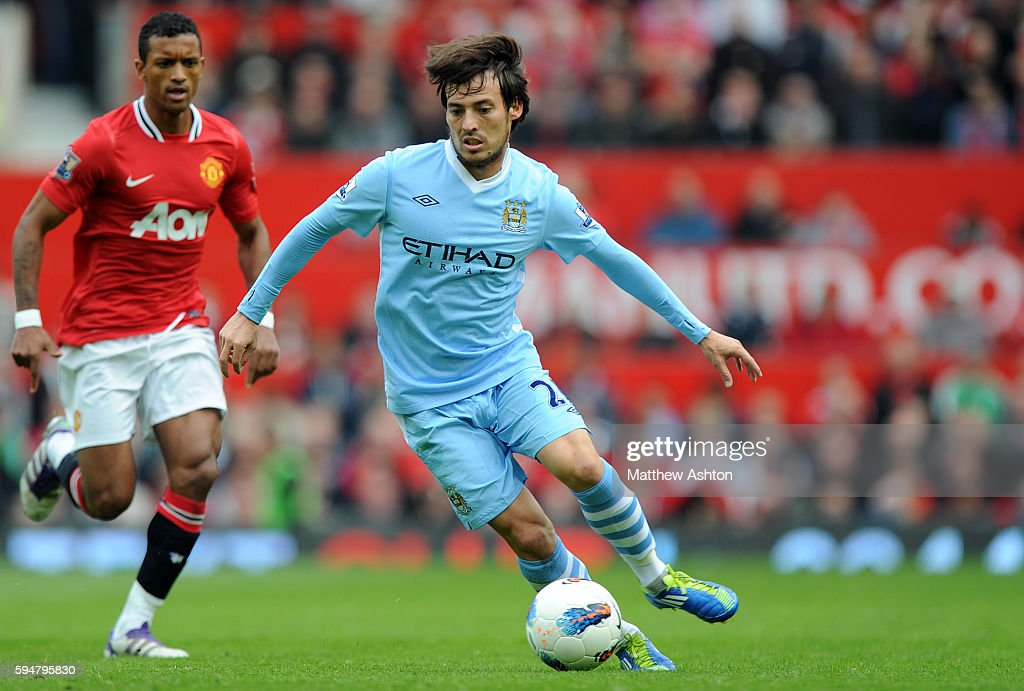 David Silva of Manchester City and Nani of Manchester United