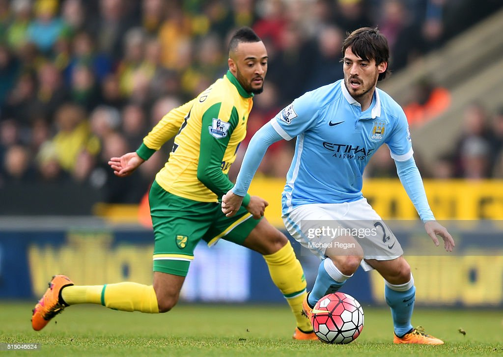 David Silva of Manchester City and Nathan Redmond of Norwich City compete for the ball during the Barclays Premier League match between Norwich City...