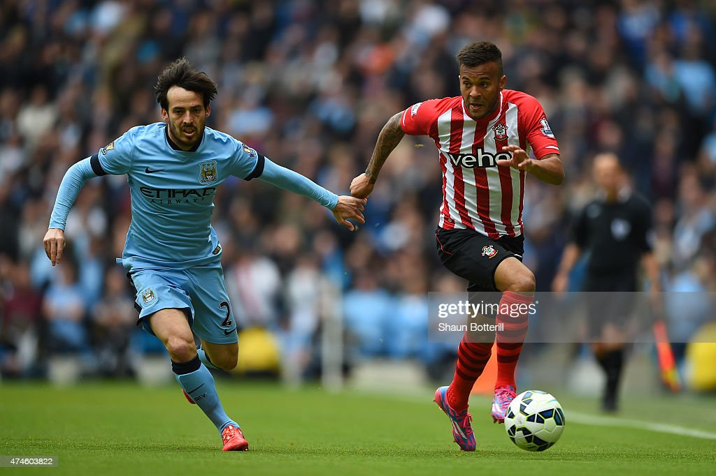 David Silva of Manchester City and Ryan Bertrand of Southampton compete for the ball during the Barclays Premier League match between Manchester City...