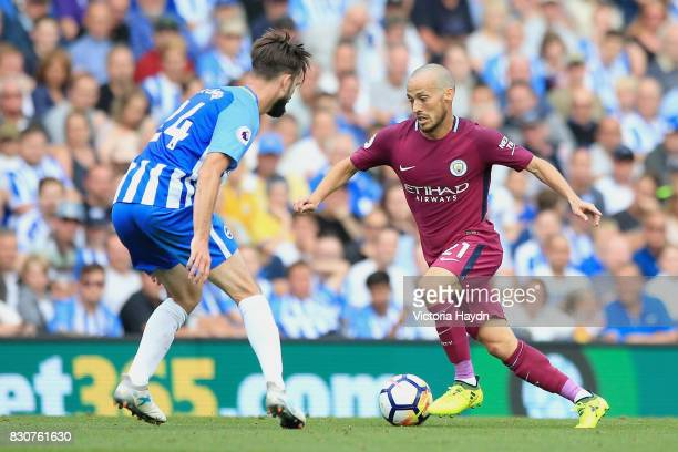 David Silva of Manchester City attempts to get past Davy Propper of Brighton and Hove Albion during the Premier League match between Brighton and...