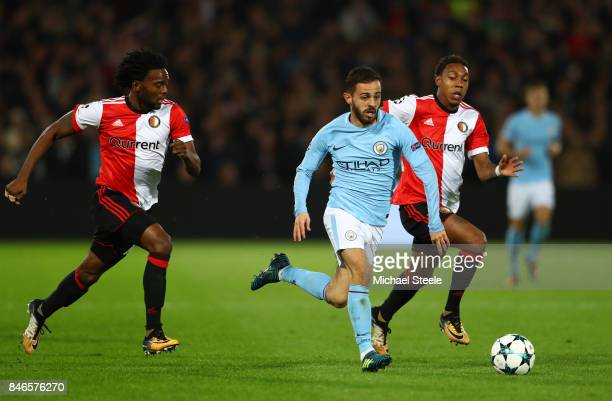 David Silva of Manchester City attempts to get past JeanPaul Boetius of Feyenoord during the UEFA Champions League group F match between Feyenoord...