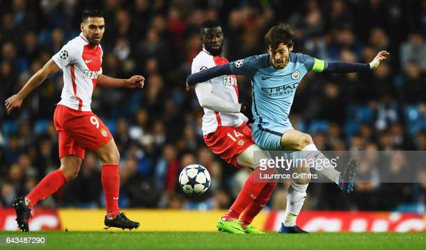 David Silva of Manchester City battles with Tiemoue Bakayoko of AS Monaco as Radamel Falcao Garcia of AS Monaco looks on during the UEFA Champions...