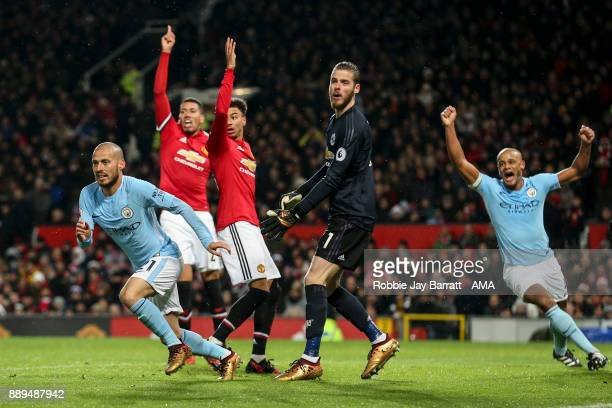 David Silva of Manchester City celebrates after scoring a goal to make it 01 during the Premier League match between Manchester United and Manchester...
