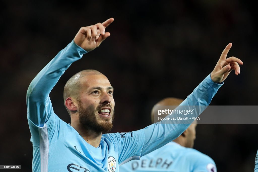 David Silva of Manchester City celebrates after scoring a goal to make it 0-1 during the Premier League match between Manchester United and Manchester City at Old Trafford on December 10, 2017 in Manchester, England.