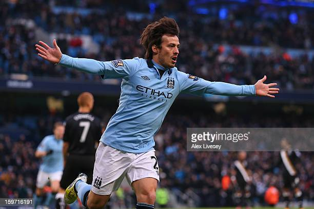 David Silva of Manchester City celebrates after scoring the opening goal during the Barclays Premier League match between Manchester City and Fulham...