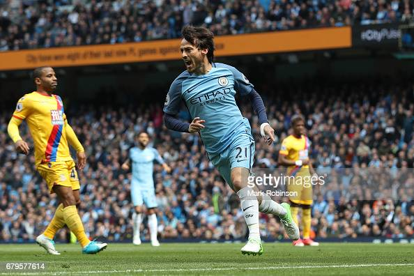 http://media.gettyimages.com/photos/david-silva-of-manchester-city-celebrates-scoring-his-sides-first-picture-id679577614?s=594x594