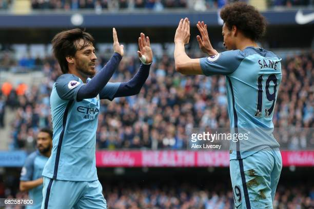 David Silva of Manchester City celebrates scoring his sides first goal with Leroy Sane of Manchester City during the Premier League match between...