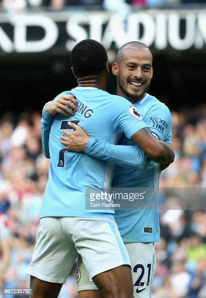 David Silva of Manchester City celebrates scoring his sides third goal with Raheem Sterling of Manchester City during the Premier League match...