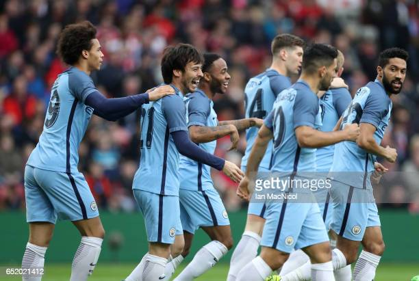 David Silva of Manchester City celebrates scoring his swides first goal with his Manchester City team mates during The Emirates FA Cup QuarterFinal...