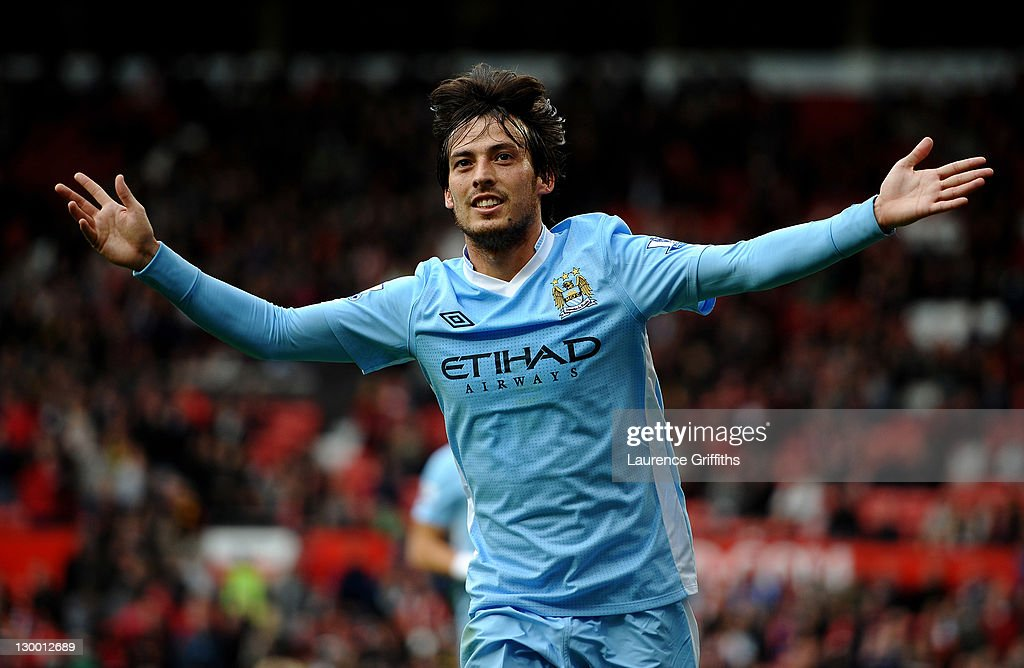 <a gi-track='captionPersonalityLinkClicked' href=/galleries/search?phrase=David+Silva&family=editorial&specificpeople=675795 ng-click='$event.stopPropagation()'>David Silva</a> of Manchester City celebrates scoring his team's fifth goal during the Barclays Premier League match between Manchester United and Manchester City at Old Trafford on October 23, 2011 in Manchester, England.