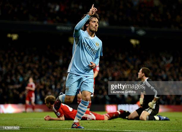 David Silva of Manchester City celebrates scoring his team's fourth goal during the Barclays Premier League match between Manchester City and West...