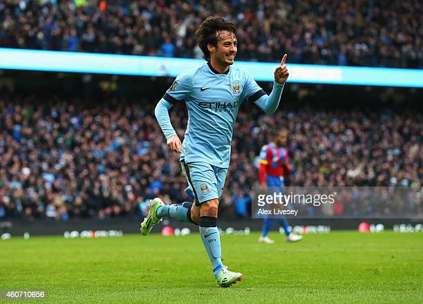 David Silva of Manchester City celebrates scoring his team's second goal during the Barclays Premier League match between Manchester City and Crystal...