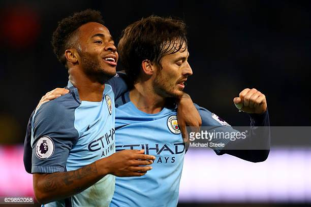 David Silva of Manchester City celebrates scoring his team's second goal with his team mate Raheem Sterling during the Premier League match between...