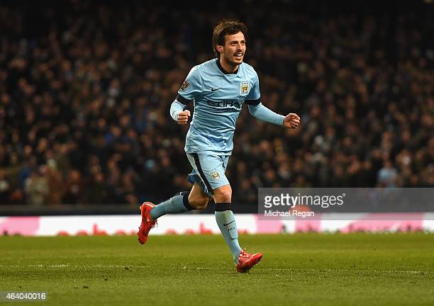 David Silva of Manchester City celebrates scoring their fifth goal during the Barclays Premier League match between Manchester City and Newcastle...