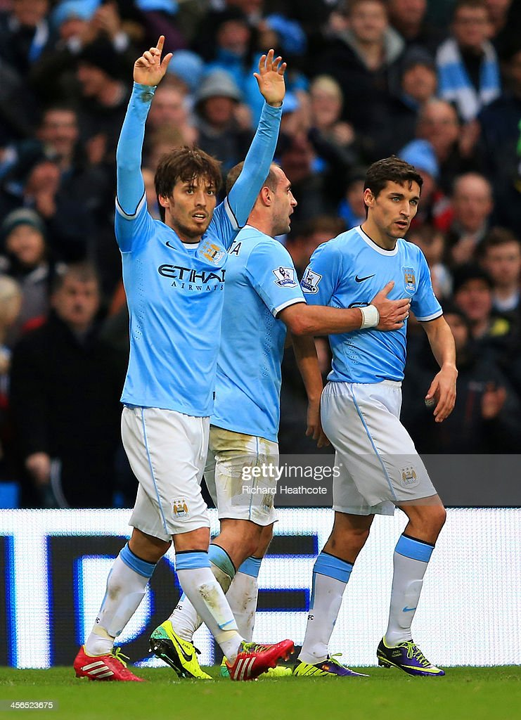 <a gi-track='captionPersonalityLinkClicked' href=/galleries/search?phrase=David+Silva&family=editorial&specificpeople=675795 ng-click='$event.stopPropagation()'>David Silva</a> of Manchester City celebrates scoring their fourth goal during the Barclays Premier League match between Manchester City and Arsenal at Etihad Stadium on December 14, 2013 in Manchester, England.