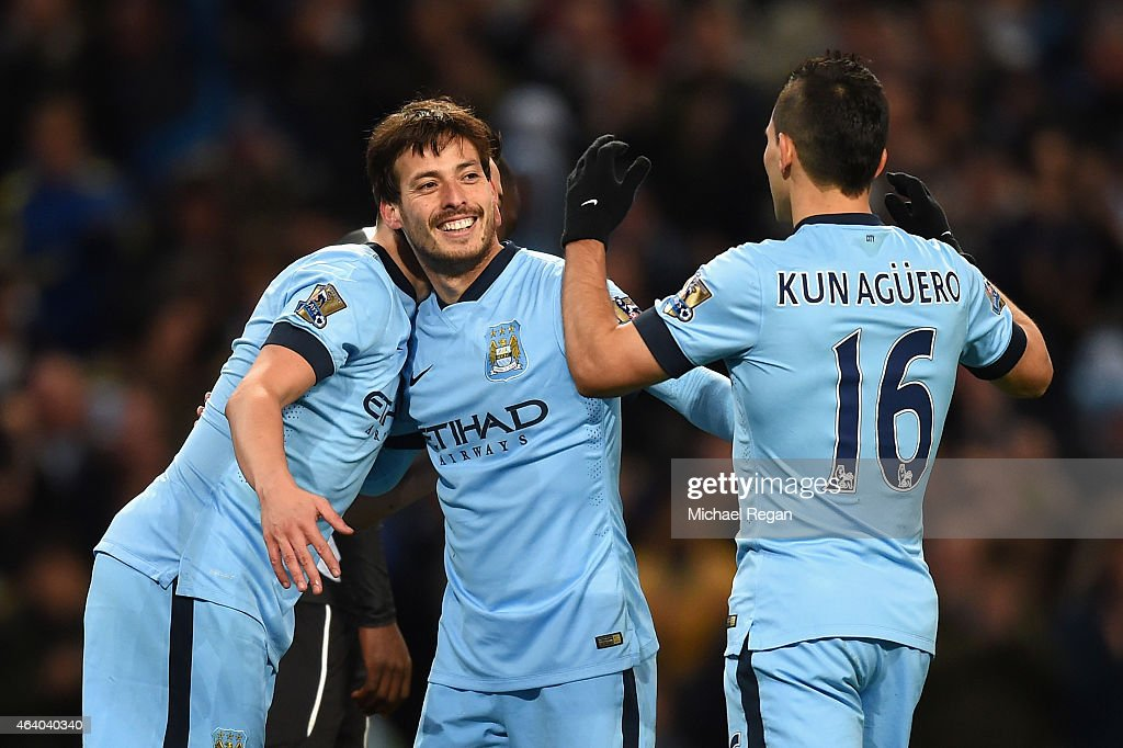 <a gi-track='captionPersonalityLinkClicked' href=/galleries/search?phrase=David+Silva&family=editorial&specificpeople=675795 ng-click='$event.stopPropagation()'>David Silva</a> of Manchester City celebrates scoring their fourth goal with <a gi-track='captionPersonalityLinkClicked' href=/galleries/search?phrase=Sergio+Aguero&family=editorial&specificpeople=1100704 ng-click='$event.stopPropagation()'>Sergio Aguero</a> and <a gi-track='captionPersonalityLinkClicked' href=/galleries/search?phrase=Samir+Nasri&family=editorial&specificpeople=648450 ng-click='$event.stopPropagation()'>Samir Nasri</a> during the Barclays Premier League match between Manchester City and Newcastle United at Etihad Stadium on February 21, 2015 in Manchester, England.