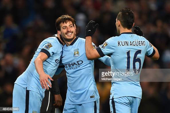 David Silva of Manchester City celebrates scoring their fourth goal with Sergio Aguero and Samir Nasri during the Barclays Premier League match...
