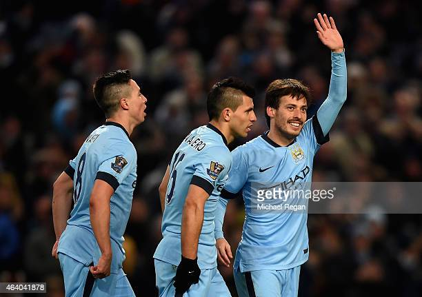 David Silva of Manchester City celebrates scoring their fourth goal during the Barclays Premier League match between Manchester City and Newcastle...