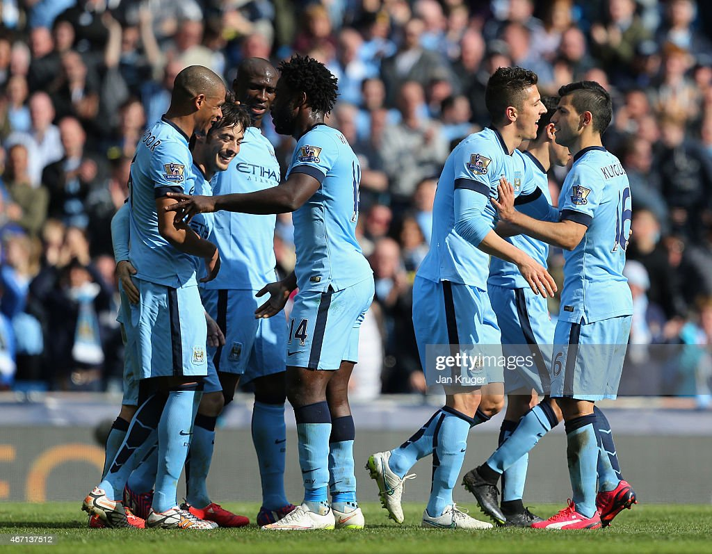 David Silva of Manchester City (2L) celebrates scoring their third goal with team mates during the Barclays Premier League match between Manchester City and West Bromwich Albion at Etihad Stadium on March 21, 2015 in Manchester, England.