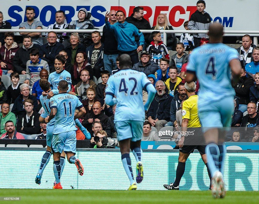 <a gi-track='captionPersonalityLinkClicked' href=/galleries/search?phrase=David+Silva&family=editorial&specificpeople=675795 ng-click='$event.stopPropagation()'>David Silva</a> (C) of Manchester City celebrates with team mates after scoring the opening goal during the Barclays Premier League match between Newcastle United and Manchester City at St.James' Park on August 17, 2014, in Newcastle upon Tyne, England.