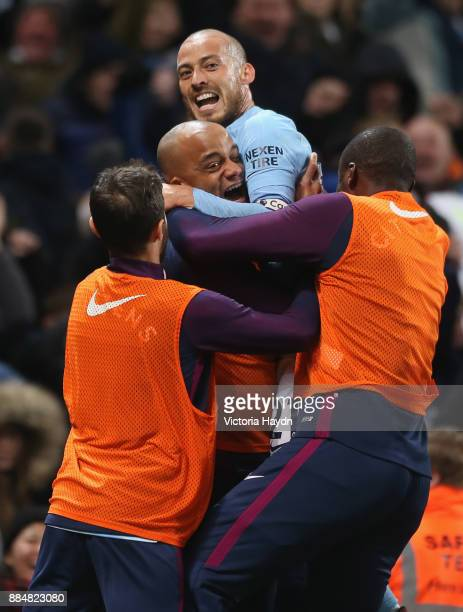 David Silva of Manchester City celebrates with Vincent Kompany of Manchester City after scoring his sides second goal during the Premier League match...