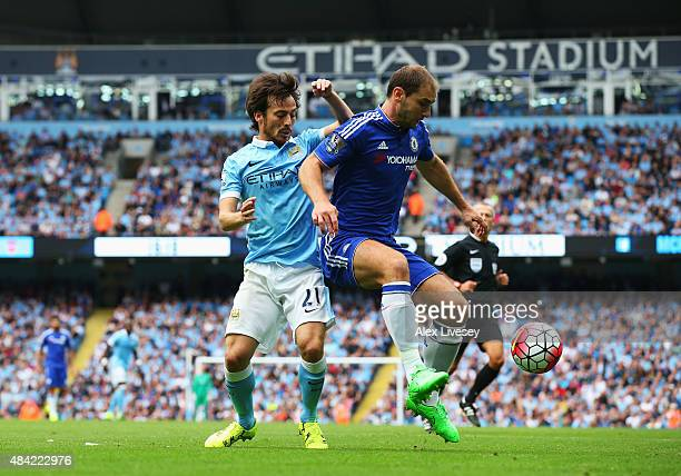 David Silva of Manchester City challenges Branislav Ivanovic of Chelsea during the Barclays Premier League match between Manchester City and Chelsea...