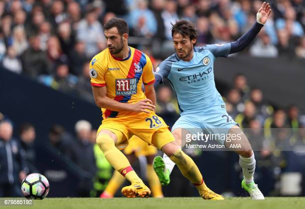 David Silva of Manchester City competes with Luka Milivojevic of Crystal Palace during the Premier League match between Manchester City and Crystal...