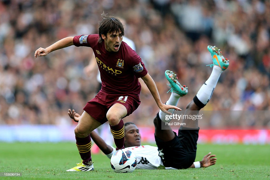 <a gi-track='captionPersonalityLinkClicked' href=/galleries/search?phrase=David+Silva&family=editorial&specificpeople=675795 ng-click='$event.stopPropagation()'>David Silva</a> of Manchester City goes past the challenge from <a gi-track='captionPersonalityLinkClicked' href=/galleries/search?phrase=Hugo+Rodallega&family=editorial&specificpeople=597054 ng-click='$event.stopPropagation()'>Hugo Rodallega</a> of Fulham during the Barclays Premier League match between Fulham and Manchester City at Craven Cottage on September 29, 2012 in London, England.