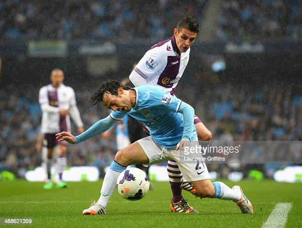 David Silva of Manchester City goes to ground after a challenge by Ashley Westwood of Aston Villa during the Barclays Premier League match between...