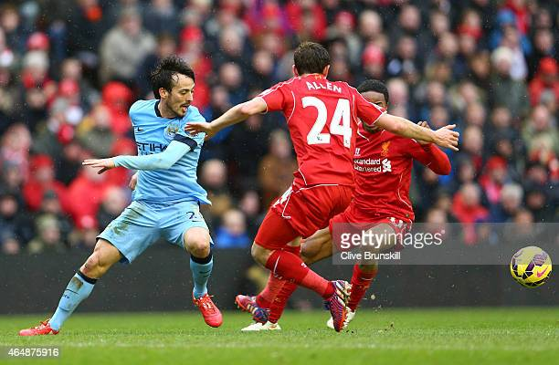 David Silva of Manchester City in action with Joe Allen and Raheem Sterling of Liverpool during the Barclays Premier League match between Liverpool...