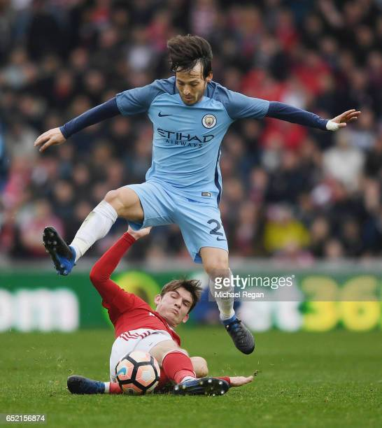 David Silva of Manchester City in action with Marten de Roon of Middlesbrough during The Emirates FA Cup QuarterFinal match between Middlesbrough and...