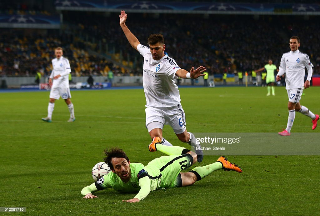 <a gi-track='captionPersonalityLinkClicked' href=/galleries/search?phrase=David+Silva&family=editorial&specificpeople=675795 ng-click='$event.stopPropagation()'>David Silva</a> of Manchester City is brought down by Aleksandar Dragovic of Dynamo Kiev during the UEFA Champions League round of 16, first leg match between FC Dynamo Kyiv and Manchester City FC at the Olympic Stadium on February 24, 2016 in Kiev, Ukraine.