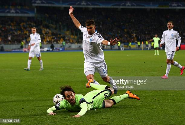 David Silva of Manchester City is brought down by Aleksandar Dragovic of Dynamo Kiev during the UEFA Champions League round of 16 first leg match...