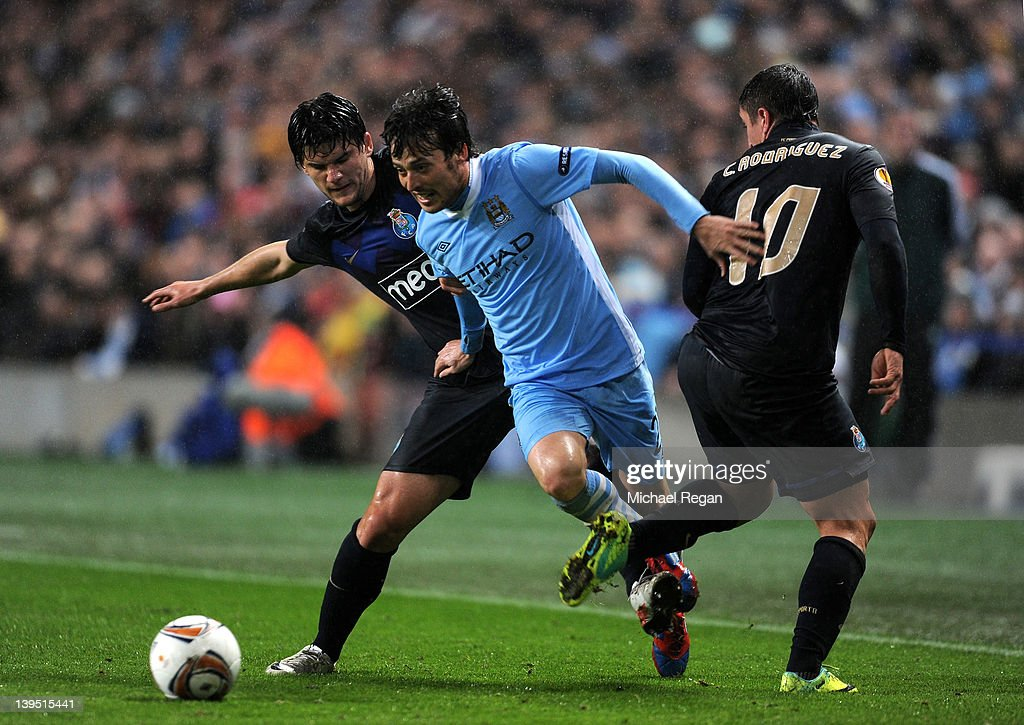 <a gi-track='captionPersonalityLinkClicked' href=/galleries/search?phrase=David+Silva&family=editorial&specificpeople=675795 ng-click='$event.stopPropagation()'>David Silva</a> of Manchester City is challenged by <a gi-track='captionPersonalityLinkClicked' href=/galleries/search?phrase=Cristian+Sapunaru&family=editorial&specificpeople=633831 ng-click='$event.stopPropagation()'>Cristian Sapunaru</a> of FC Porto (L) during the UEFA Europa League Round of 32 second leg match between Manchester City and FC Porto at the Etihad Stadium on February 22, 2012 in Manchester, England.