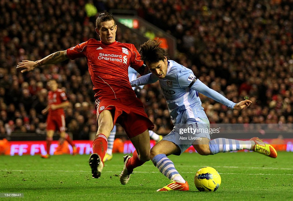 <a gi-track='captionPersonalityLinkClicked' href=/galleries/search?phrase=David+Silva&family=editorial&specificpeople=675795 ng-click='$event.stopPropagation()'>David Silva</a> of Manchester City is challenged by <a gi-track='captionPersonalityLinkClicked' href=/galleries/search?phrase=Daniel+Agger&family=editorial&specificpeople=605441 ng-click='$event.stopPropagation()'>Daniel Agger</a> of Liverpool during the Barclays Premier League match between Liverpool and Manchester City at Anfield on November 27, 2011 in Liverpool, England.