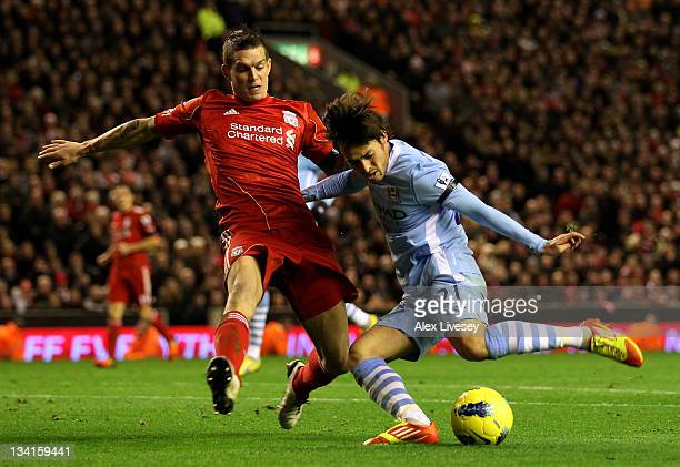David Silva of Manchester City is challenged by Daniel Agger of Liverpool during the Barclays Premier League match between Liverpool and Manchester...