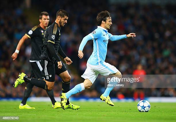 David Silva of Manchester City is chased by Alvaro Morata of Juventus during the UEFA Champions League Group D match between Manchester City FC and...