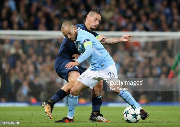 David Silva of Manchester City is fouled by Marek Hamsik of SSC Napoli during the UEFA Champions League group F match between Manchester City and SSC...