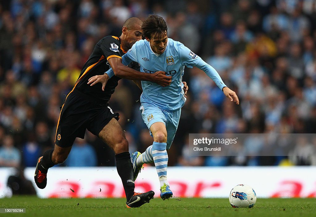 <a gi-track='captionPersonalityLinkClicked' href=/galleries/search?phrase=David+Silva&family=editorial&specificpeople=675795 ng-click='$event.stopPropagation()'>David Silva</a> of Manchester City is held by <a gi-track='captionPersonalityLinkClicked' href=/galleries/search?phrase=Karl+Henry&family=editorial&specificpeople=2093810 ng-click='$event.stopPropagation()'>Karl Henry</a> of Wolverhampton Wanderers during the Barclays Premier League match between Manchester City and Wolverhampton Wanderers at Etihad Stadium on October 29, 2011 in Manchester, England.