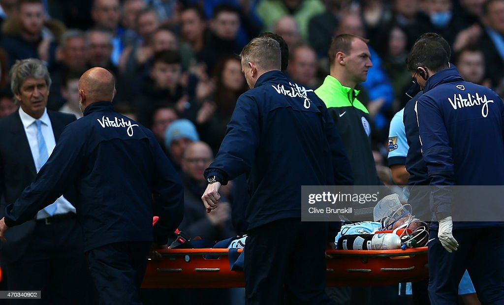 David Silva of Manchester City is stretchered off during the Barclays Premier League match between Manchester City and West Ham United at Etihad Stadium on April 19, 2015 in Manchester, England.