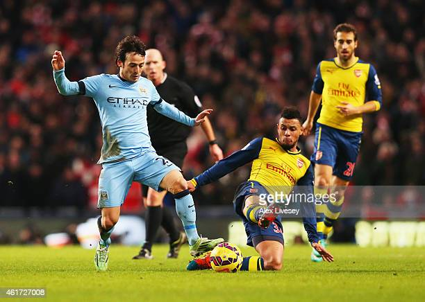 David Silva of Manchester City is tackled by Francis Coquelin of Arsenal during the Barclays Premier League match between Manchester City and Arsenal...
