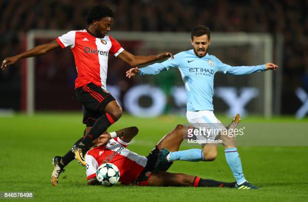 David Silva of Manchester City is tackled by Miquel Nelom of Feyenoord and JeanPaul Boetius of Feyenoord during the UEFA Champions League group F...