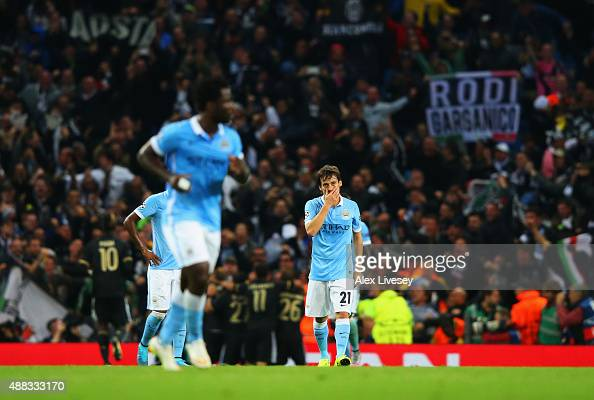David Silva of Manchester City looks dejected as Mario Mandzukic of Juventus scores their first and euqlaising goal during the UEFA Champions League...