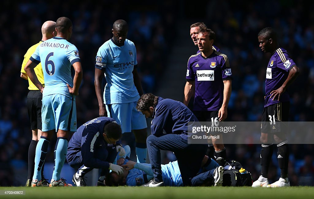 David Silva of Manchester City receives medical treatment during the Barclays Premier League match between Manchester City and West Ham United at Etihad Stadium on April 19, 2015 in Manchester, England.