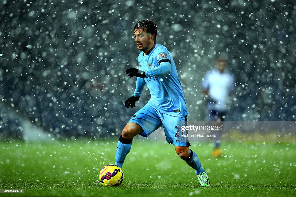 <a gi-track='captionPersonalityLinkClicked' href=/galleries/search?phrase=David+Silva&family=editorial&specificpeople=675795 ng-click='$event.stopPropagation()'>David Silva</a> of Manchester City runs with the ball during the Barclays Premier League match between West Bromwich Albion and Manchester City at The Hawthorns on December 26, 2014 in West Bromwich, England.