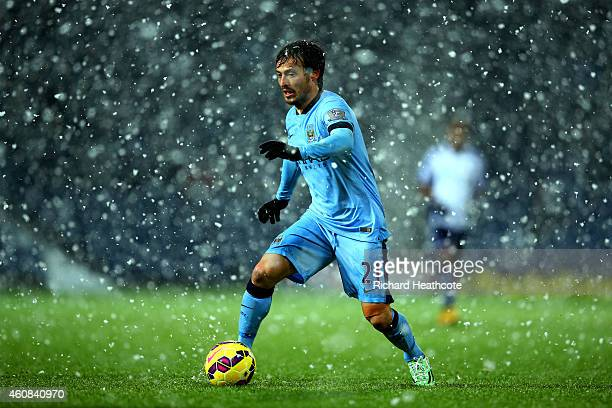 David Silva of Manchester City runs with the ball during the Barclays Premier League match between West Bromwich Albion and Manchester City at The...