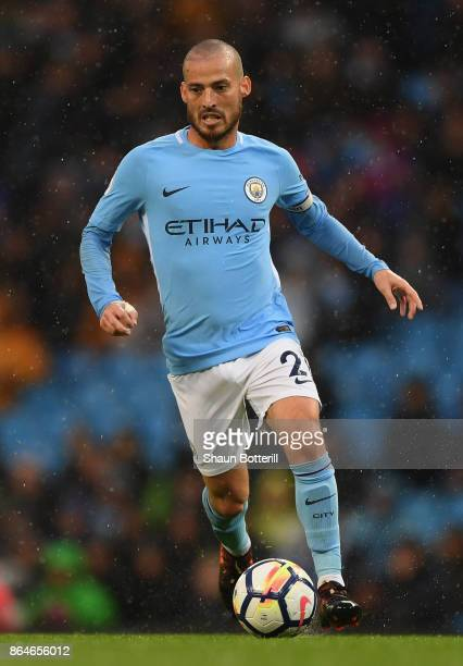 David Silva of Manchester City runs with the ball during the Premier League match between Manchester City and Burnley at Etihad Stadium on October 21...