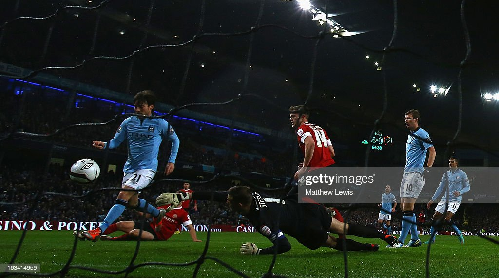 <a gi-track='captionPersonalityLinkClicked' href=/galleries/search?phrase=David+Silva&family=editorial&specificpeople=675795 ng-click='$event.stopPropagation()'>David Silva</a> of Manchester City scores a goal during the FA Cup sponsored by Budweiser Sixth Round match between Manchester City and Barnsley at Etihad Stadium on March 9, 2013 in Manchester, England.